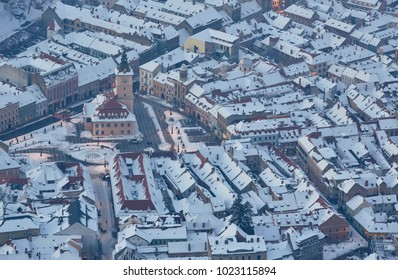 Bird's eye view of the snowy Council Square in the historic center of Brasov city, Romania.