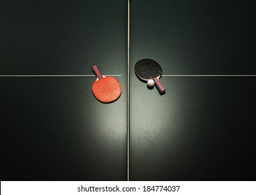 Birds eye view of table tennis table and ping pong paddles. Concept of sports competition