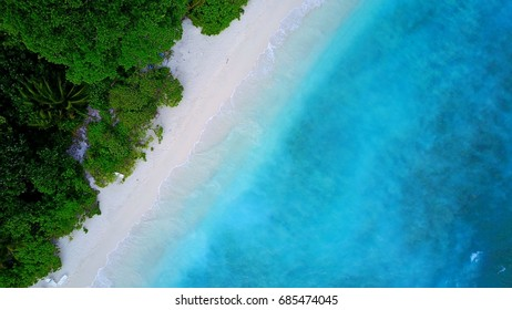 Bird's eye view of tropical beach and blue sea