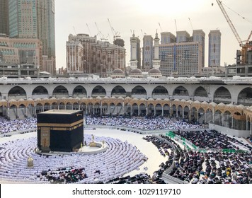 Bird's eye view of unidentified Muslim pilgrims in prostration (sujod) position facing the Kaabah during day time.
