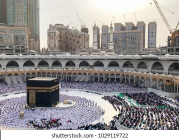 Bird's eye view of unidentified Muslim pilgrims in sitting  position facing the Kaabah during day time.