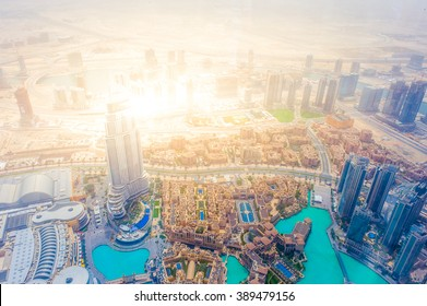 Birds eye view urban landscape from Burj with shining lights of the downtown business central area of the city of gold, Dubai, UAE