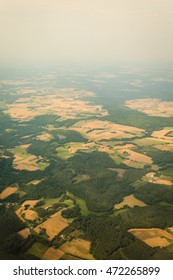 Birds eye. View from window of plane airplane flying over Poland Europe.