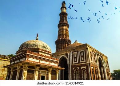 birds fly over Qutub Minar, Qutab Minar, or Qutb Minar, new delhi, india