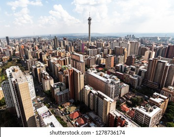 Birds perspective on the notorious city of Hillbrow, one of the most dangerous parts of Johannesburg in South Africa with the telephone tower in the centre in landscape format on a sunny day