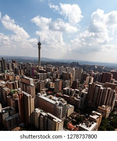 Birds perspective on the notorious city of Hillbrow, one of the most dangerous parts of Johannesburg in South Africa with the telephone tower in the centre in horizontal format on a sunny day