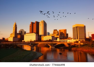 Birds take flight while fishermen fish on the Scioto River in Columbus, Ohio