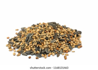 Birdseed in front of white background