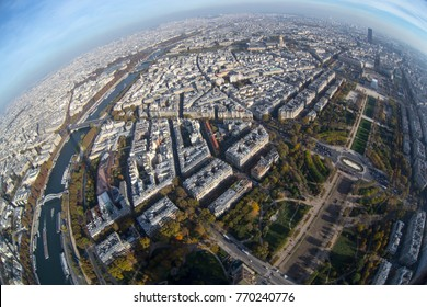 Bird's-eye view to autumn river Seine and Paris  from Eiffel Tower. Eiffel Tower is iconic landmarks of France. Tourism in Europe, travel concept. Squeeze horizon, fish eye lens,  city panorama.