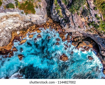 Birdseye view of cliffs, stones, rocks close to Watsons Bay