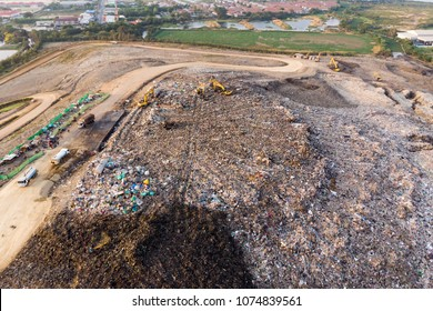 Bird's-eye view from drone of large garbage pile, degraded garbage. Pile of stink and toxic residue / Garbage pile in trash dump or landfill - Environmental pollution