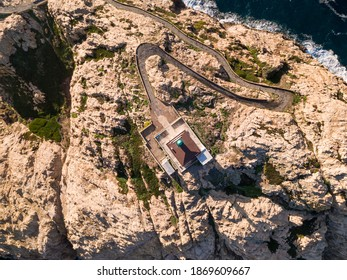 Birds-eye view of early morning sun on the lighthouse at La Pietra in Ile Rousse in the Balagne region of Corsica