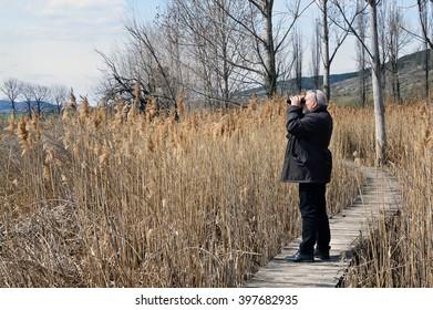 Birdwatcher in Dragoman Swamp - Bulgarian Natural Reserve and unique bird species habitat
