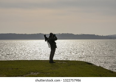 Birdwatcher in Keyhaven and Lymington nature reserve