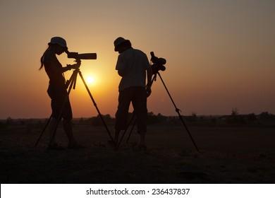 Birdwatchers backlit