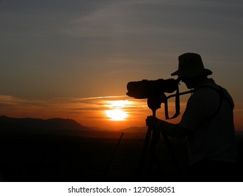 Birdwatching at sunrise with an scope in Spain