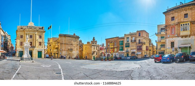 BIRGU, MALTA - JUNE 17, 2018: The wide panorama of Victory square with a view on St Lawrence statue, San Lawrenz Parish Hall, old edifices and mansions, on June 17 in Birgu.
