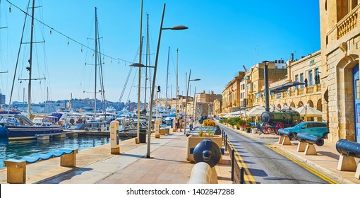 BIRGU MALTA - JUNE 19, 2018: The scenic Xatt Il-Forn promenade is the best place for the walk, it boasts cozy cafes, restaurants, seaside views and historic architecture, on June 19 in Birgu