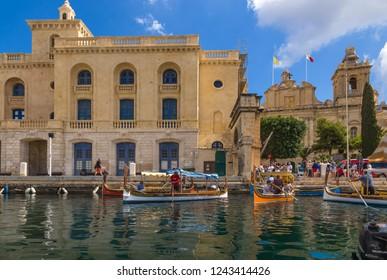 BIRGU, MALTA - SEP 21, 2016: Traditional Maltese painted dghajsa boats  at the pier