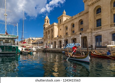 BIRGU, MALTA - SEP 21, 2016: parking of yachts and traditional maltese dghajsa boats  at the Maritime Museum
