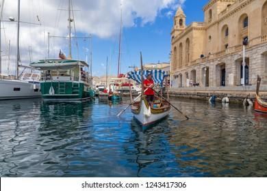 BIRGU, MALTA - SEP 21, 2016: Yachts and traditional Maltese dghajsa boats  at the pier