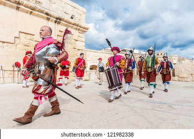 BIRGU - NOV 04: In Guardia re-enactment portraying the inspection of the fort and its garrison by the Grand Bailiff of the Order of the Knights of St. John on November 04, 2012 in Birgu, Malta.