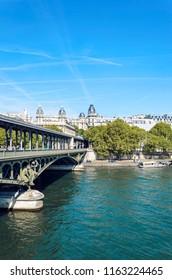 Bir-Hakeim  bridge over the Seine river in Paris, France on sunny spring day, vertical