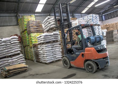 Biritiba Mirim, São Paulo, Brazil, March 13, 2013. Forklift works in the stock with products in the warehouse of deliveries of the agricultural products retailer, in the municipality of Biritiba-Mirim
