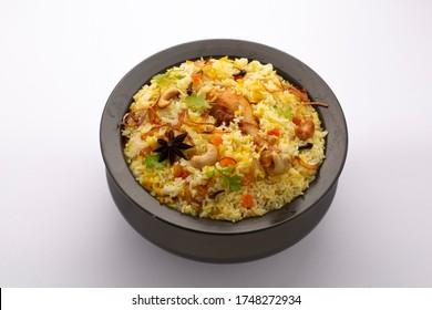 Biriyani_ chicken dum biriyani _kerala special  and tasty food garnished with spices,cashewnut  and coriander - Shutterstock ID 1748272934