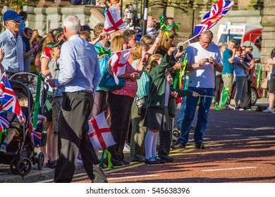 Birkenhead, United Kingdom - May 2, 2013 : People gathering to see olympic torchbearer run