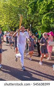 Birkenhead, United Kingdom - May 2, 2013 : Olympic Torchbearer