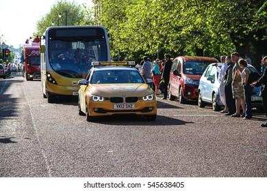 Birkenhead, United Kingdom - May 2, 2013 : Yellow Car carrying crew for torchbearer run