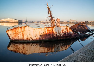 Birkenhead, Wirral, Merseyside, England, Britain, December 2014, partially submerged wreck of RV Sarsia at East Float Dock