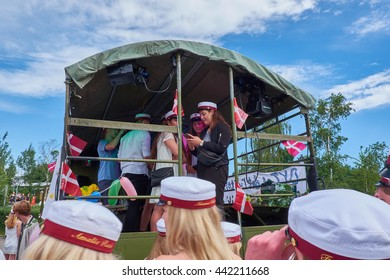 BIRKEROED, DENMARK - JUNE 23, 2016: Traditional day in Denmark when all the high school students graduates. Here students are entering the back of a truck.