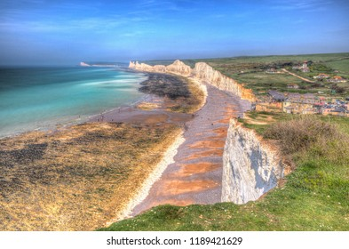 Birling gap beach near and the Seven Sisters chalk cliffs and Beachy head East Sussex UK in colourful hdr