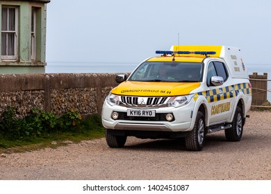 Birling Gap, Sussex, UK. 20th May 2019. HM Coastguard team are deployed after the discovory of an unexploded shell at the foot of Beachy Head