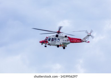 Birling Gap, Sussex, UK - 9th June 2019:  HM Coastguard helicopter G-MCGP conducts a shoreline search of the cliff edge after reports of persons cut off by the tide.