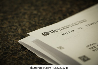 Birmingham, AL / USA - October 7, 2020: Opened letter from the IRS showing the logo on the corner of the paper with selective focus