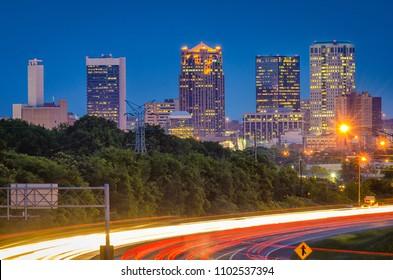 Birmingham, Alabama, USA highway and skyline at dusk.