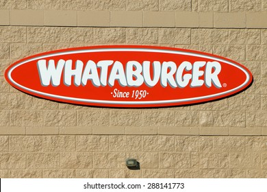 BIRMINGHAM, AL-JUNE, 2015:  Sign and logo for Whataburger.  Whataburger is an American regional fast food restaurant chain with over 750 locations that specializes in hamburgers.