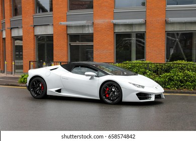 Birmingham, England - 03.06.17: Lamborghini Huracan Spyder supercar on a road in Four Oaks district in Birmingham.