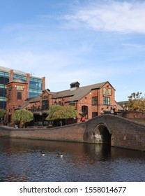 BIRMINGHAM, ENGLAND - OCTOBER 19, 2019: View of Birmingham Canal with The Malt House pub and Arena Birmingham, England