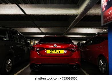 Birmingham, England - October 2017: Alfa Romeo Giulia Quadrifoglio performance saloon parked in central Birmingham shopping mall.