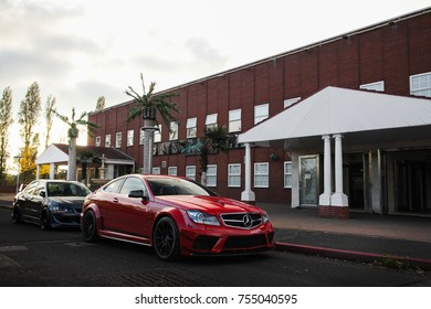 Birmingham, England - October 2017: Mercedes-Benz C63 AMG Black Series sports car parked at MSL Performance car event. A Japanese sports car Mitsubishi Lancer Evolution is parked behing Mercedes.