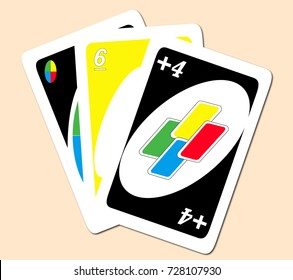 BIRMINGHAM, ENGLAND, OCTOBER 4TH 2017, three Uno game cards. American card game, light background.