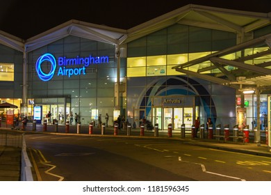 BIRMINGHAM, ENGLAND - SEPTEMBER 2018: Illuminated sign at night on the terminal building at Birmingham airport.