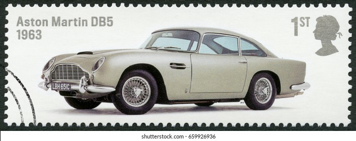 BIRMINGHAM, GREAT BRITAIN - AUGUST 13, 2013: A stamp printed in Great Britain shows Aston Martin DB5 1963, series British Auto Legends, 2013