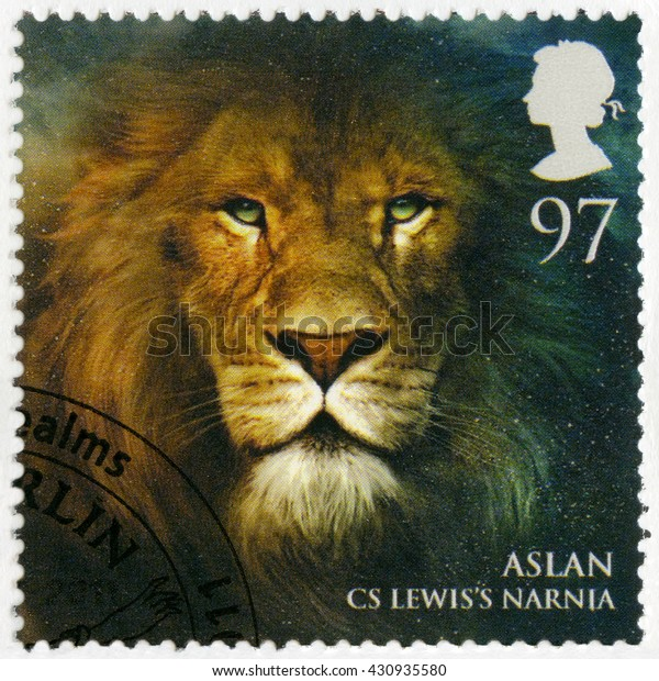 BIRMINGHAM, GREAT BRITAIN - MARCH 08, 2011: A stamp printed in Great Britain shows portrait of Aslan, Narnia, series Magical Realms