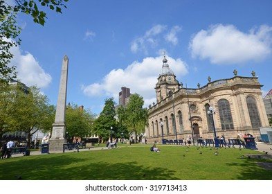 Birmingham - June 16, 2015: view of St Philip's Cathedral and the Burnaby Obelisk in Birmingham, UK. The cathedral is the third smallest in England.