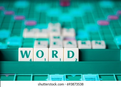 BIRMINGHAM, UK 10TH AUGUST 2017 - Scrabble letters forming word 'word' with words play, game ad learn blurred in the background